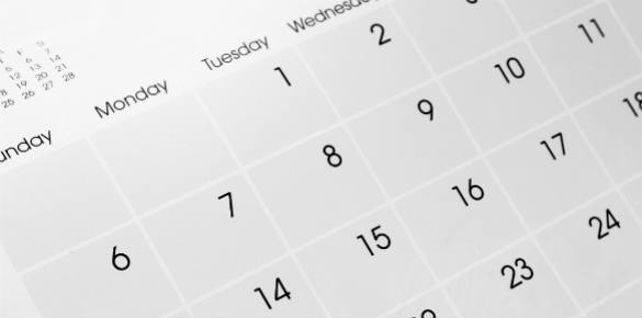 A close up of a calendar showing days and dates.