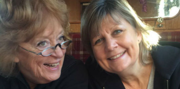 A head shot of two middle aged ladies, one with glasses.